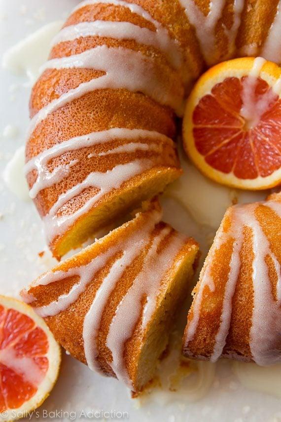 Bright, flavorful, CRAZY moist, and tender orange bundt cake! Find the recipe on sallysbakingaddiction.com