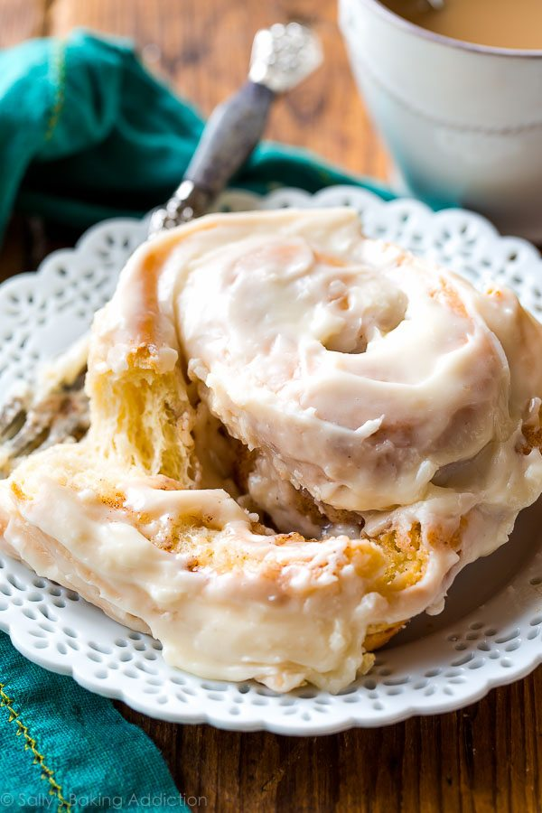 Learn how to make big giant cinnamon rolls-- almost double the size of your typical and covered with cream cheese frosting! Recipe on sallysbakingaddiction.com