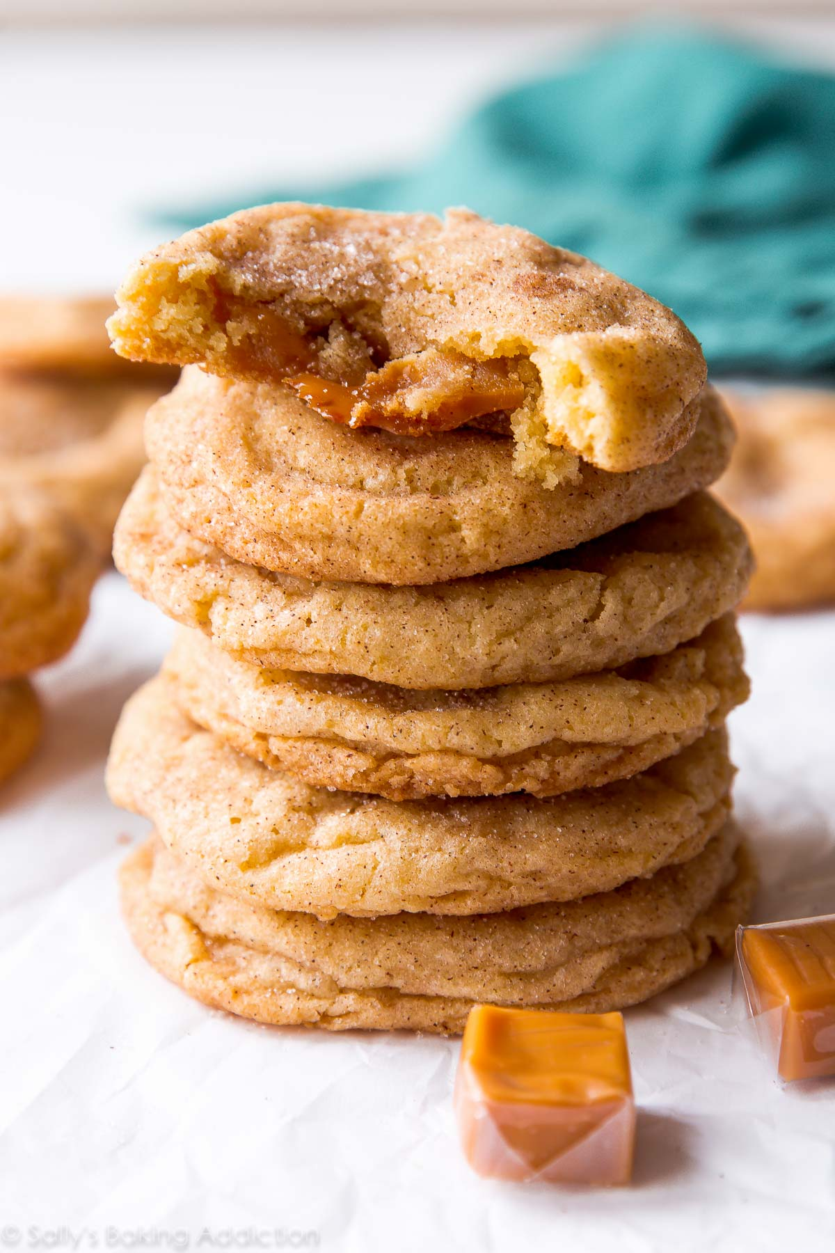 Pillowy soft caramel snickerdoodles with chewy edges and a caramel surprise inside! Recipe on sallysbakingaddiction.com