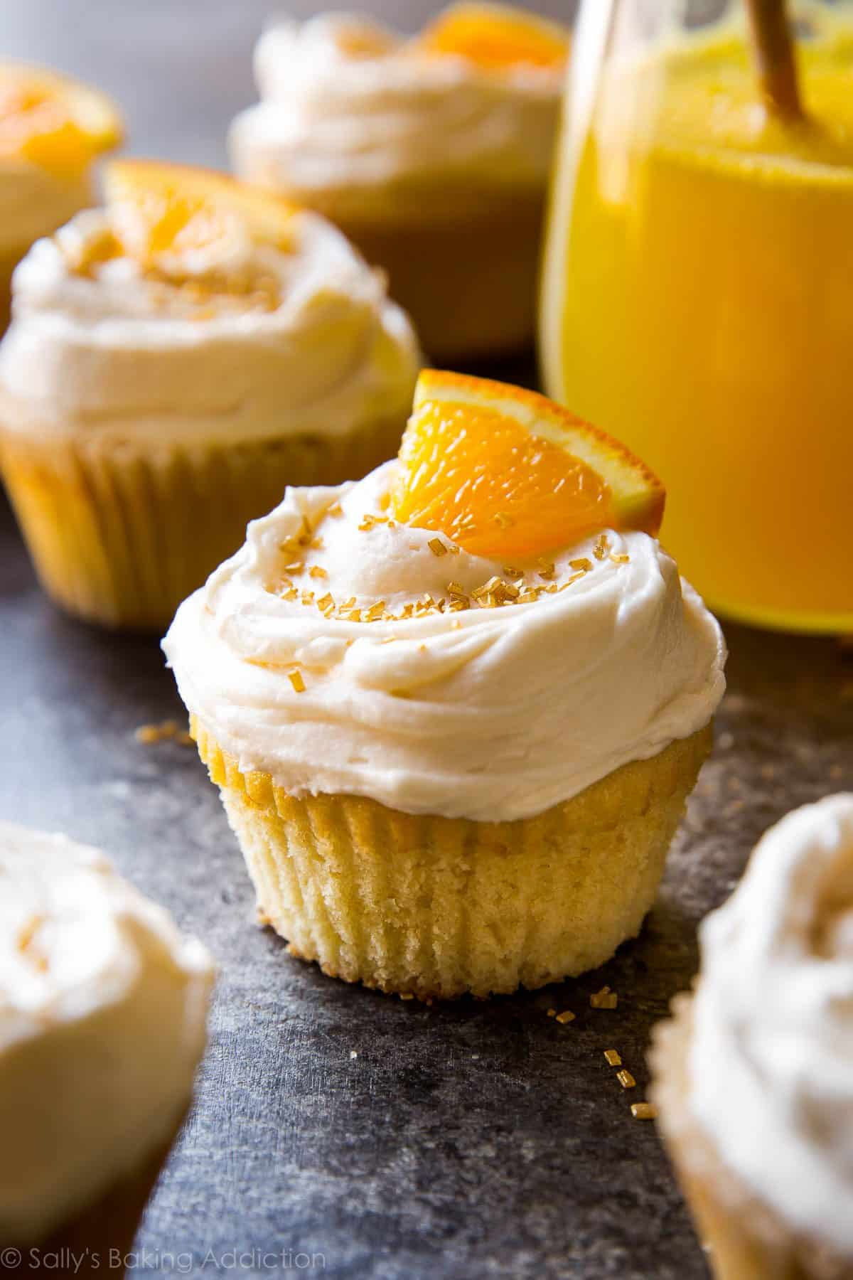 Cheers! Soft and fluffy mimosa cupcakes with champagne frosting recipe on sallysbakingaddiction.com