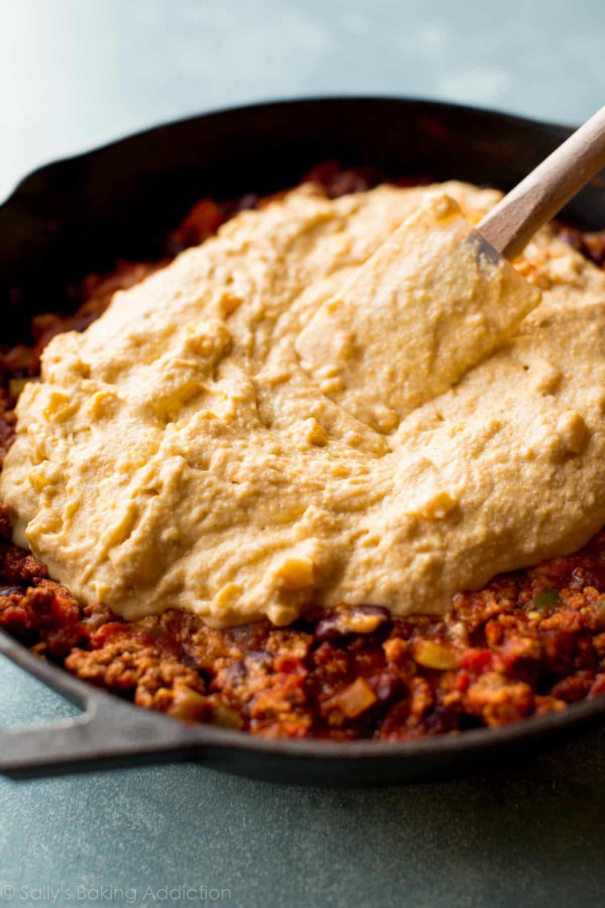 How to make cornbread skillet chili on sallysbakingaddiction.com