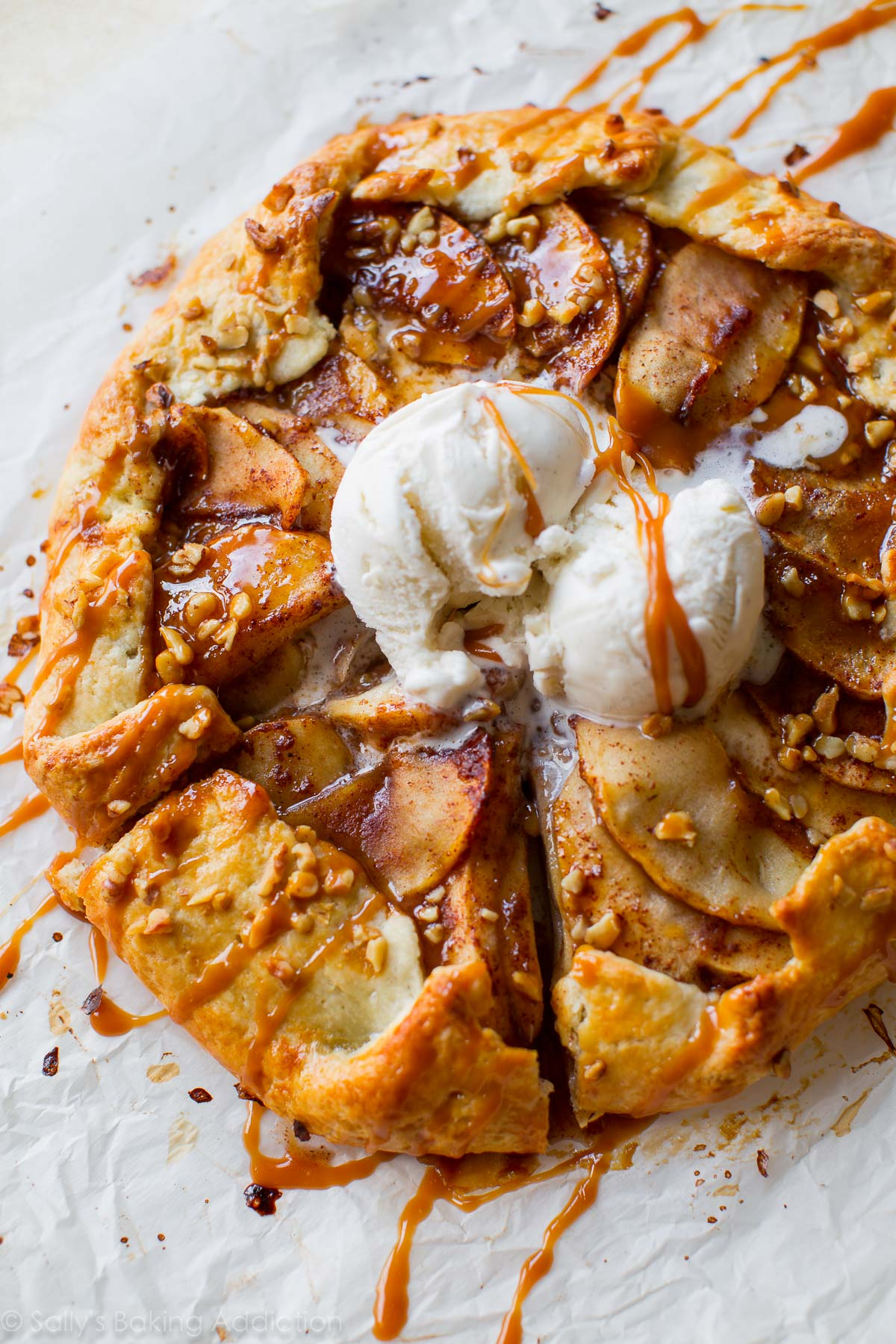 As delicious and impressive as pie, but half the work! This salted caramel apple galette is the easiest Fall dessert. Recipe on sallysbakingaddiction.com