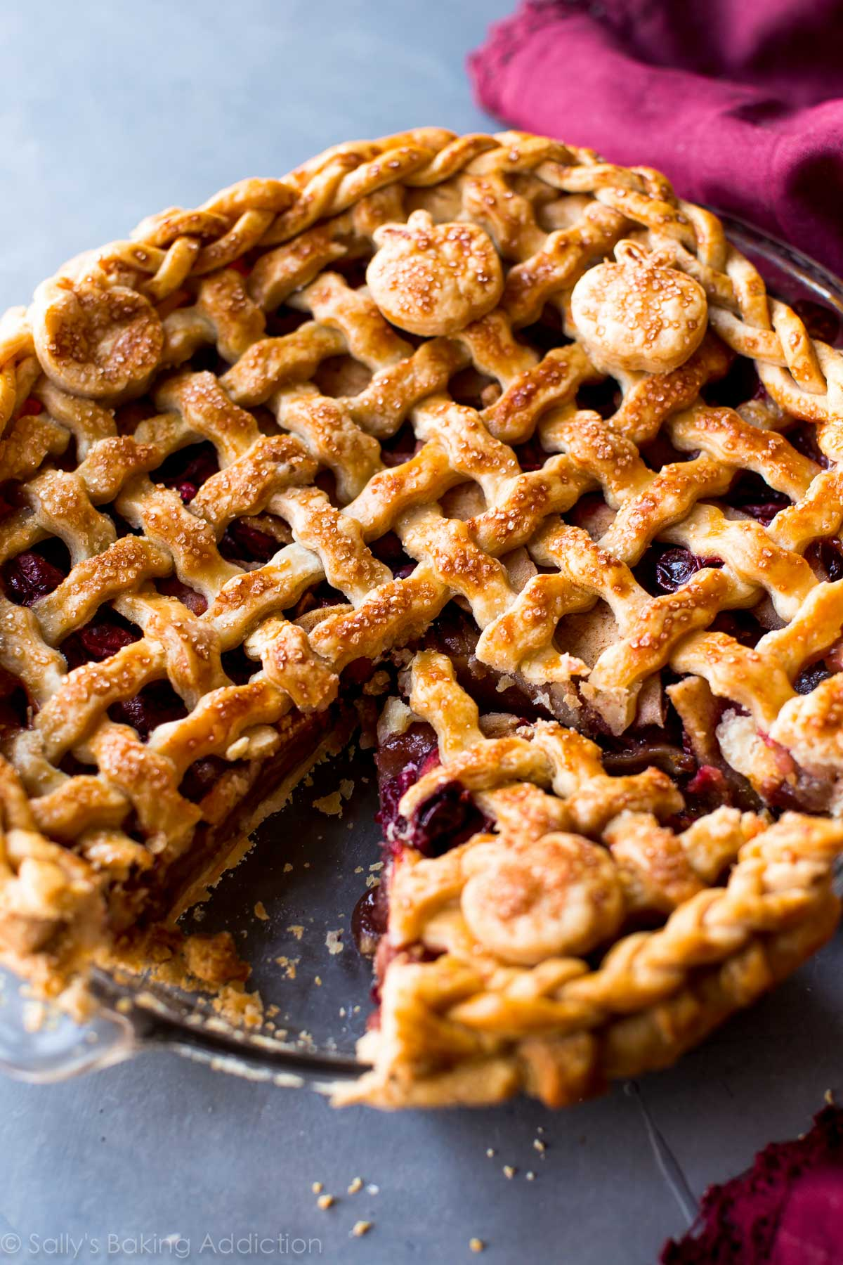 Sweet cinnamon apples and tart cranberries come together in this incredible Thanksgiving pie! Recipe on sallysbakingaddiction.com
