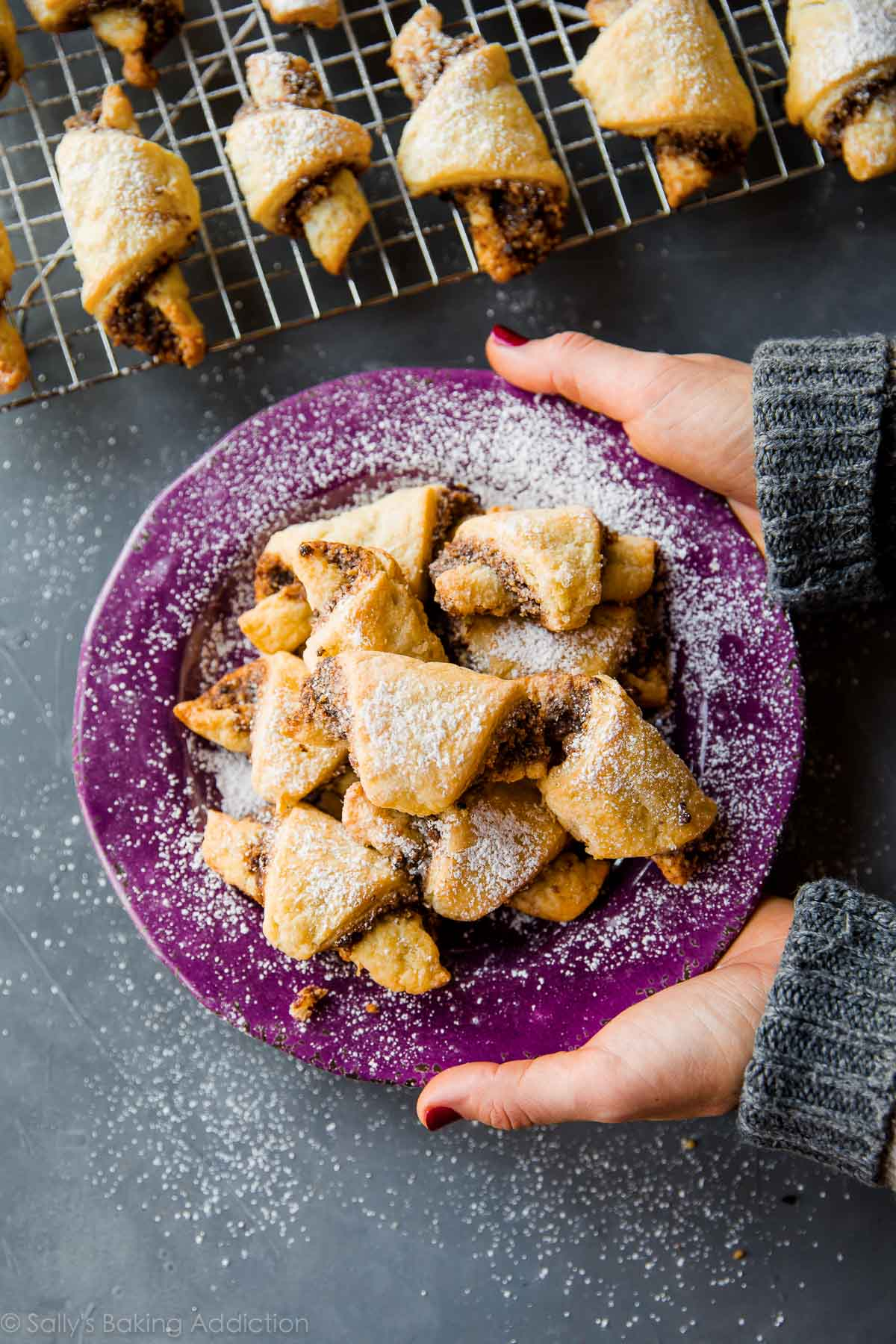 Buttery, flaky rugelach with a light and crisp pastry dough and sweet cinnamon filling! Recipe on sallysbakingaddiction.com