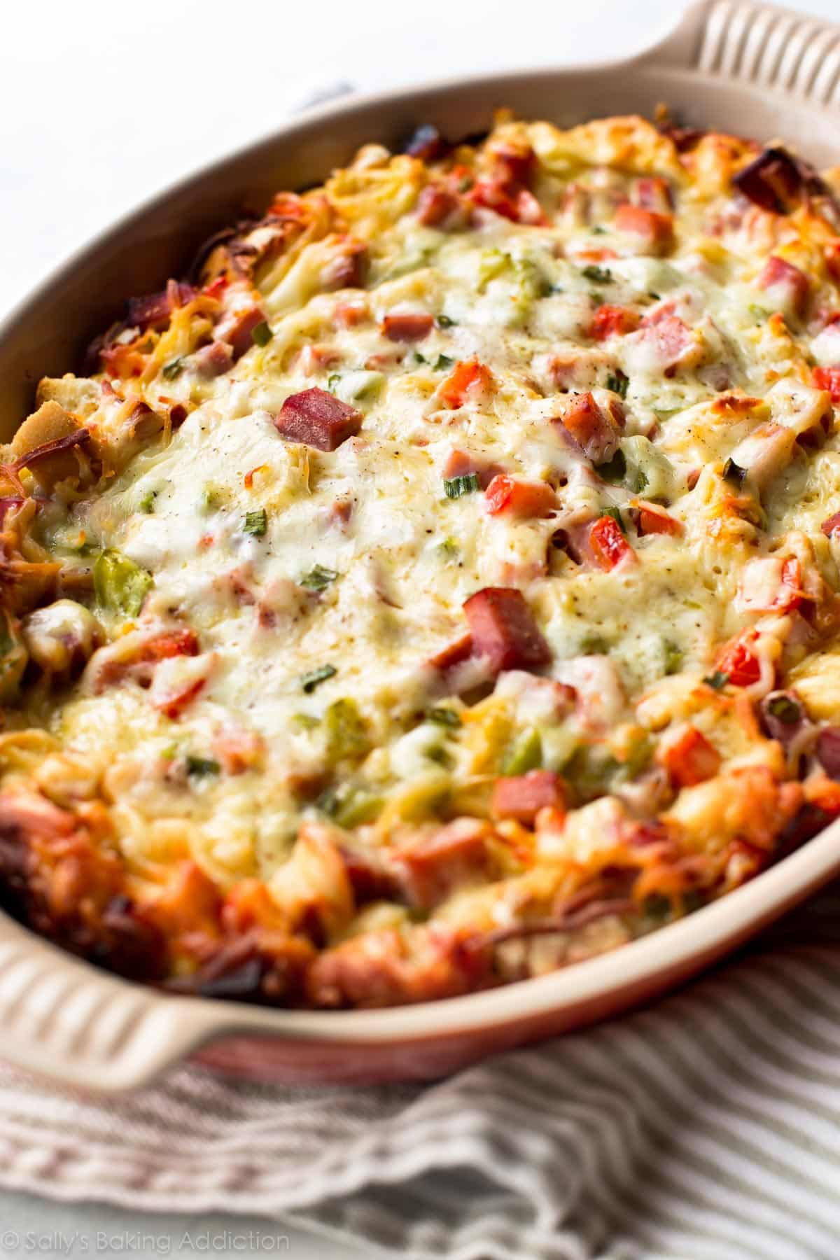 Prep this delicious overnight ham & cheese strata the night before so there's little work in the morning! Recipe on sallysbakingaddiction.com