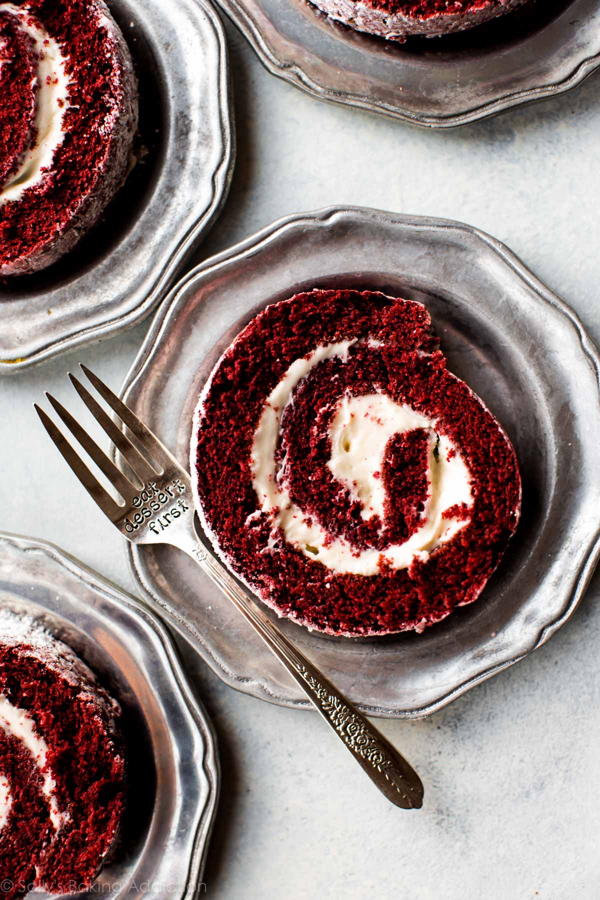 Learn how to make a deliciously soft red velvet cake roll using this step-by-step photo tutorial and recipe! sallysbakingaddiction.com