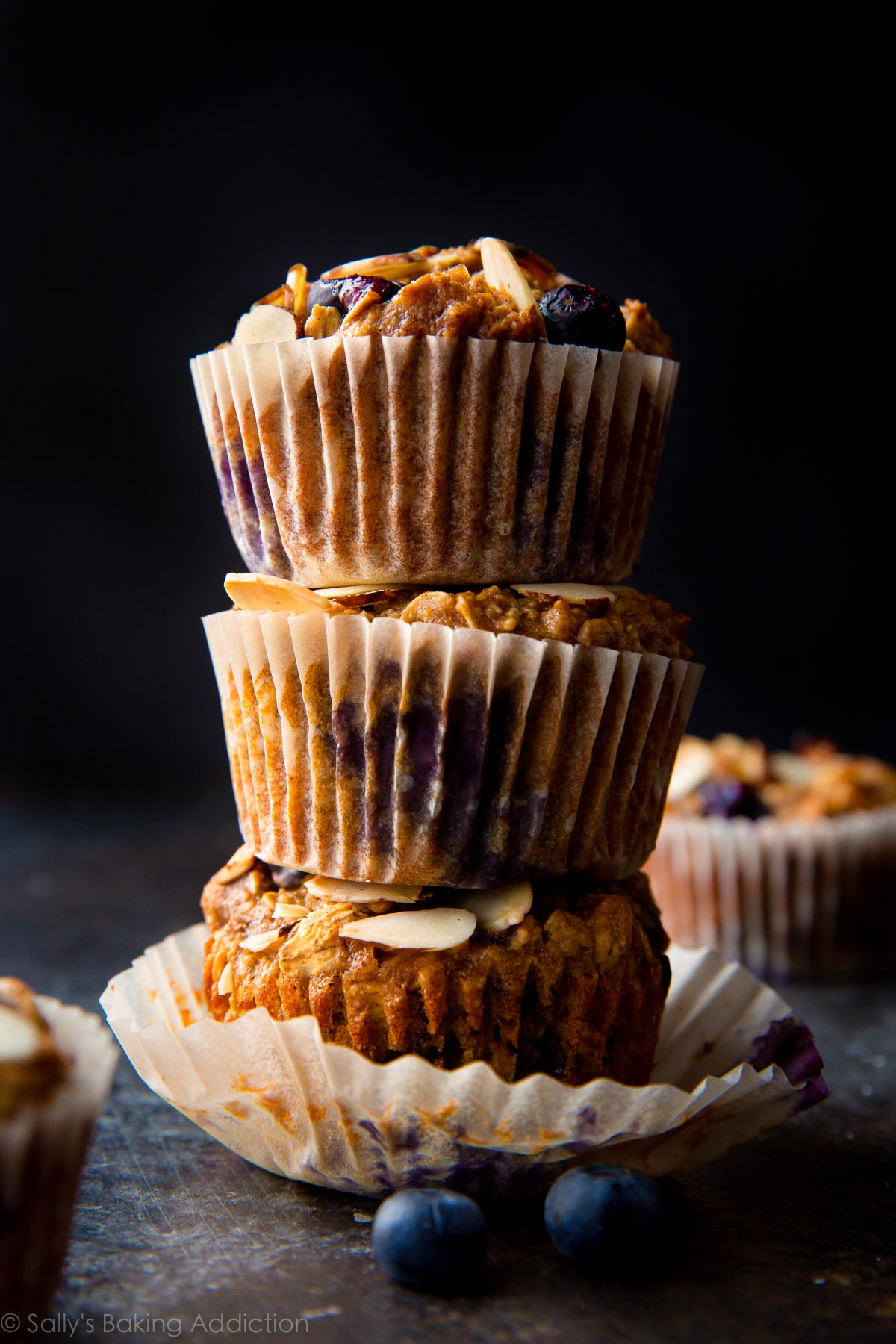 These gluten free blueberry almond muffins are wholesome and satisfying and are made with almond butter, Greek yogurt, oats, and almond flour! Recipe on sallysbakingaddiction.com