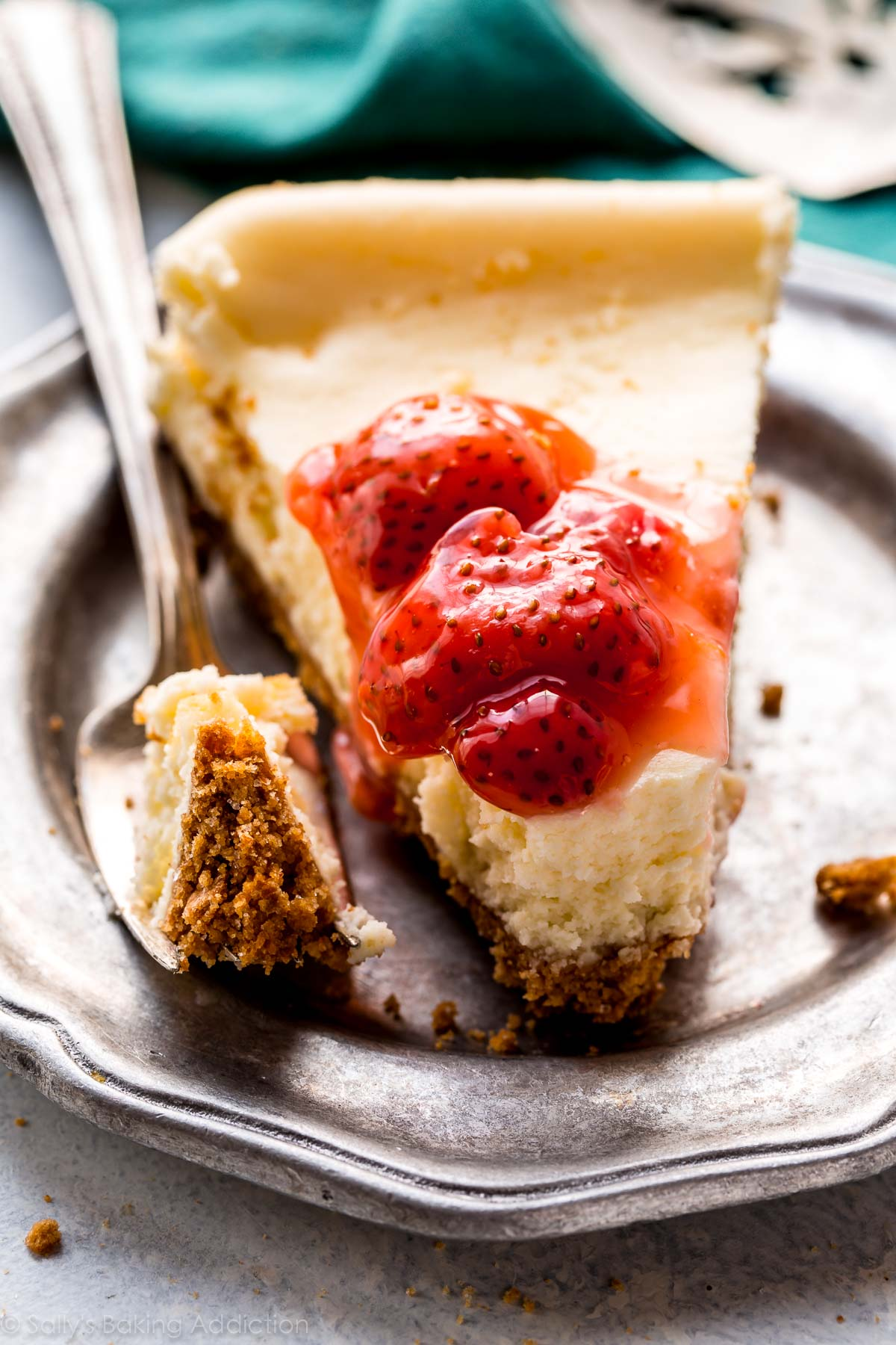Small batch cheesecake is so easy! Make these 5 deliciously creamy and thick slices in a loaf pan! Recipe on sallysbakingaddiction.com