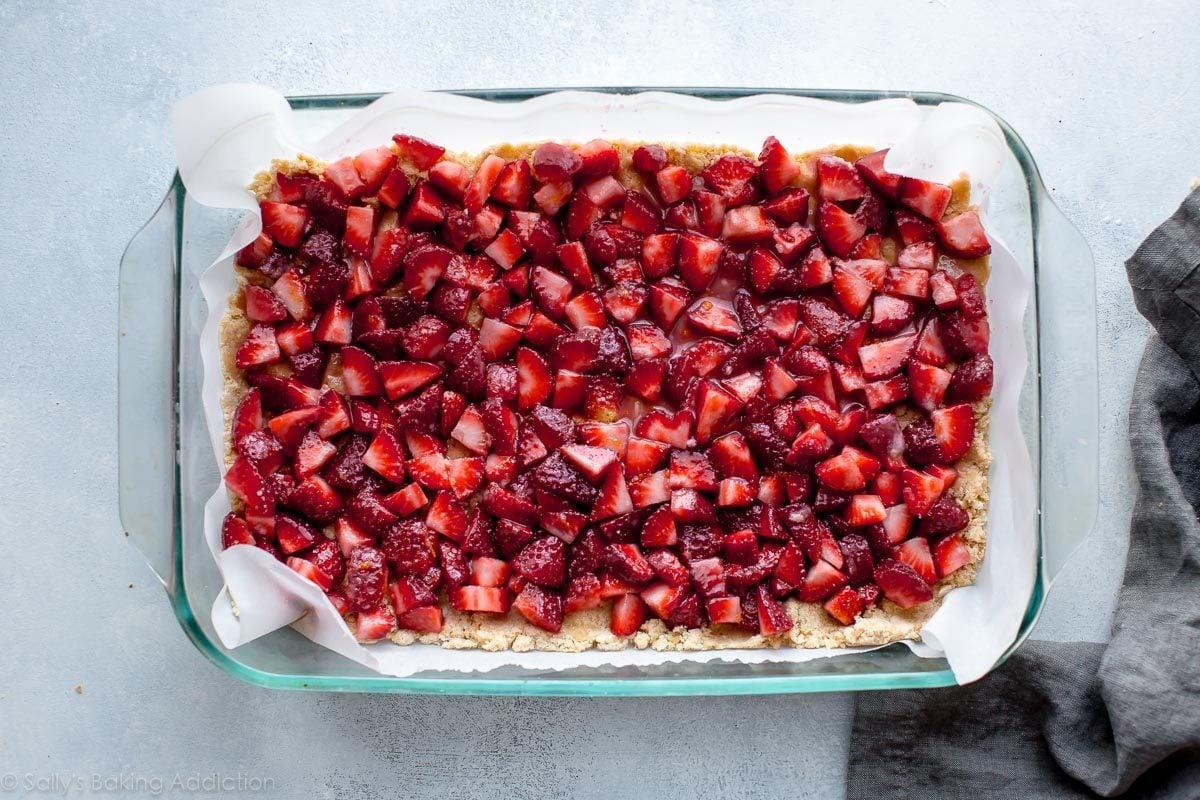 How to make lemon strawberry crumb bars on sallysbakingaddiction.com