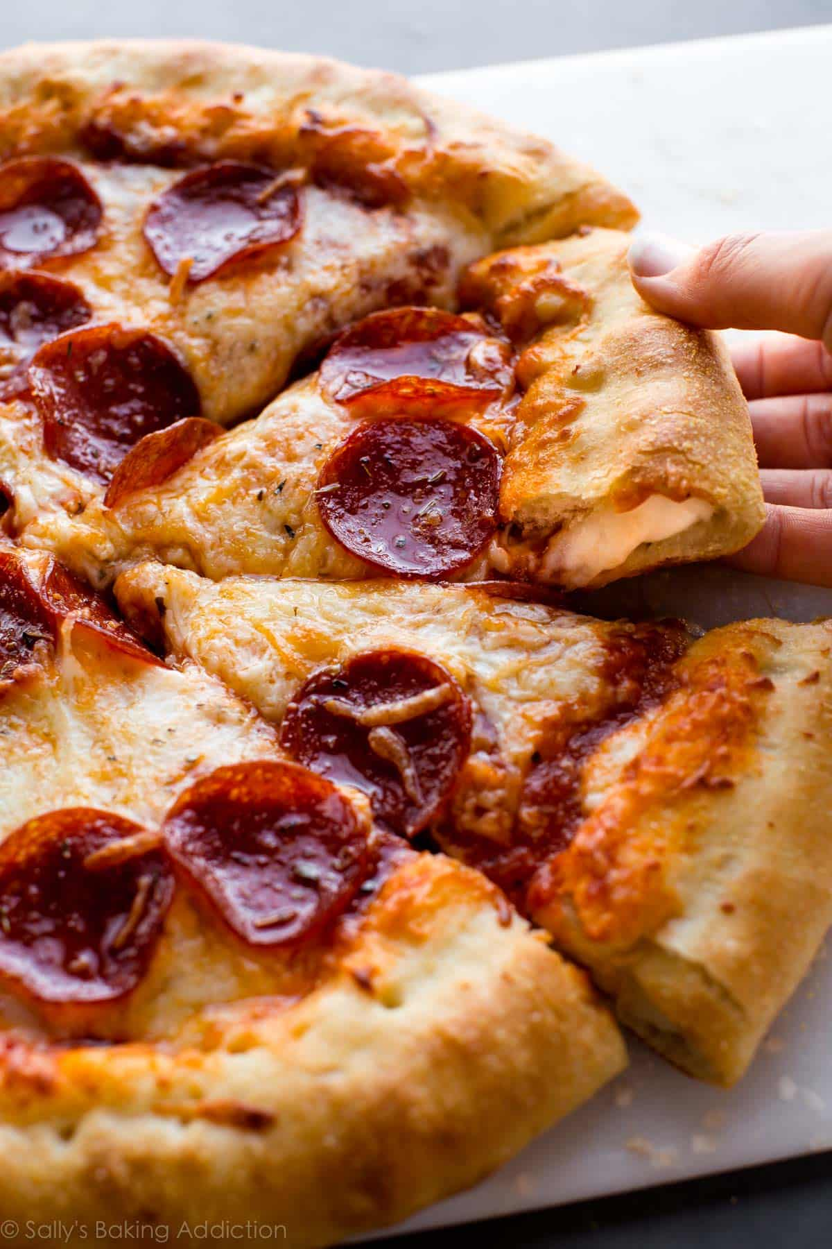 How to make stuffed crust cheese pepperoni pizza on sallysbakingaddiction.com EASY homemade pizza crust!