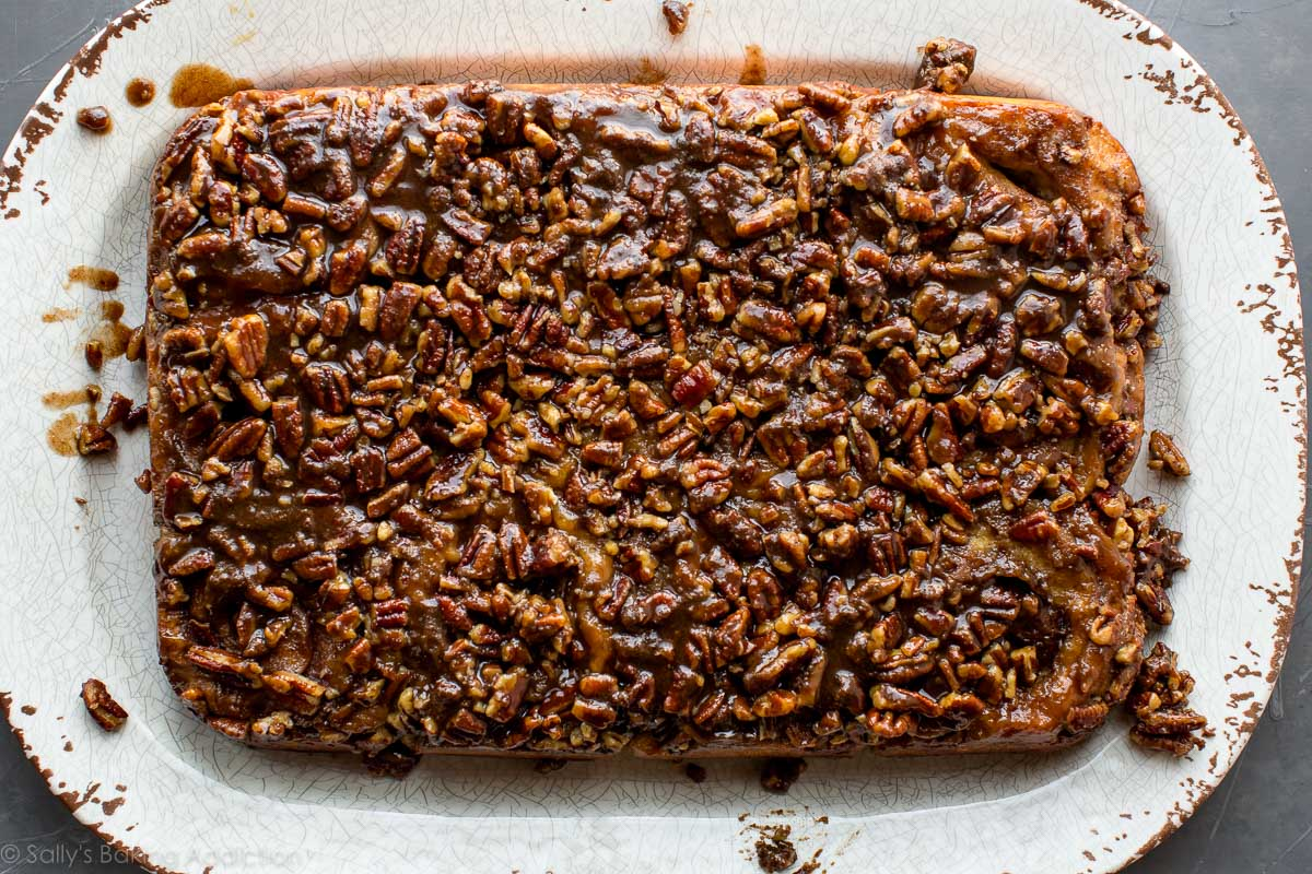Unbelievably soft, rich, and decadent maple pecan sticky buns with extra brown sugar caramel topping! Recipe on sallysbakingaddiction.com