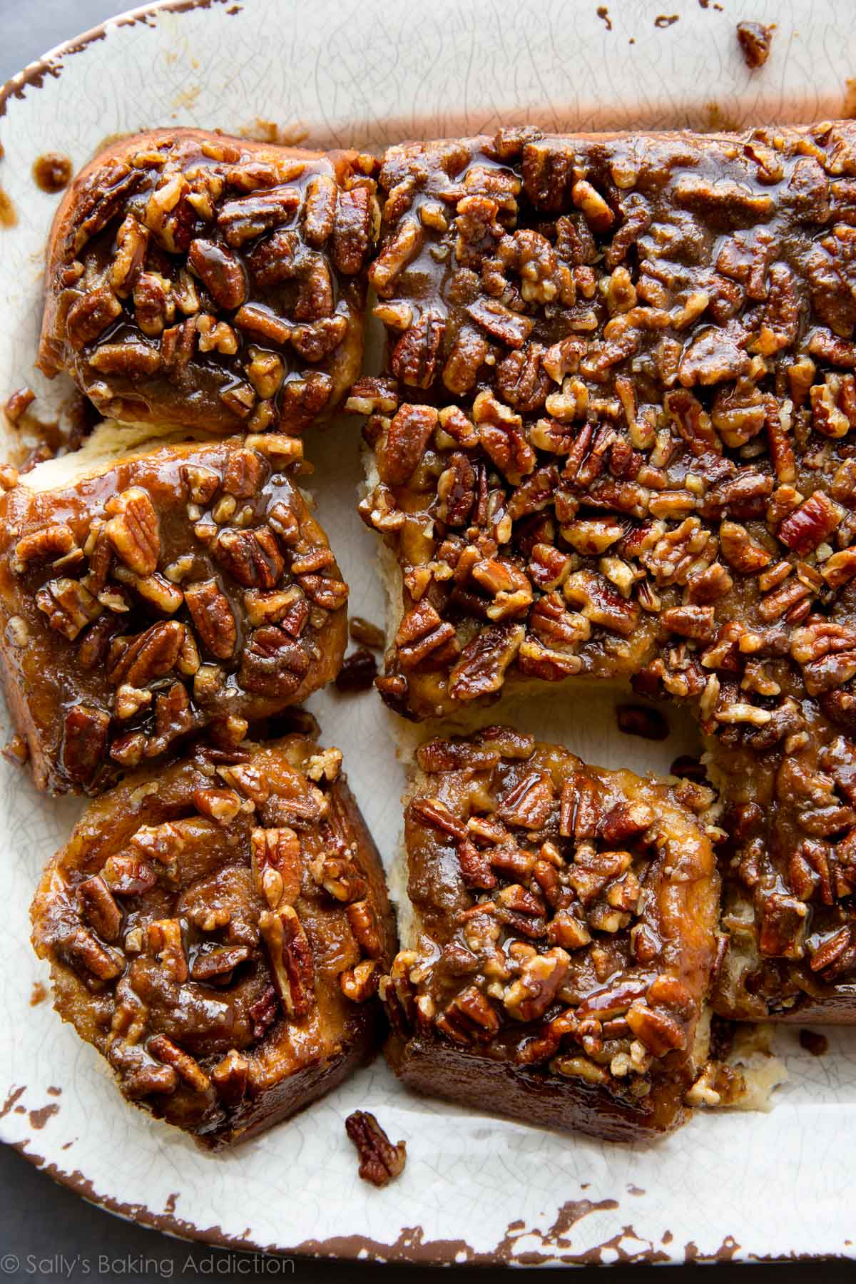 Breakfast and brunch have never been more indulgent and delicious than with these make-ahead maple pecan sticky buns! Recipe on sallysbakingaddiction.com