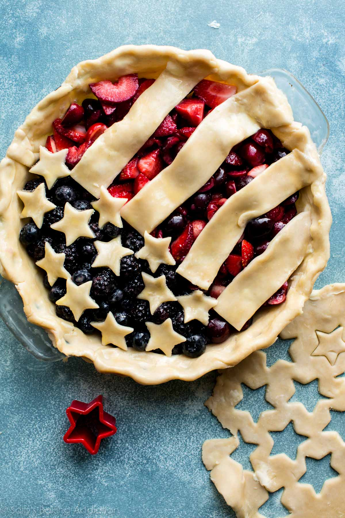 How to make an easy American Flag Pie! Mixed berry fillings and flaky pie crust recipe on sallysbakingaddiction.com