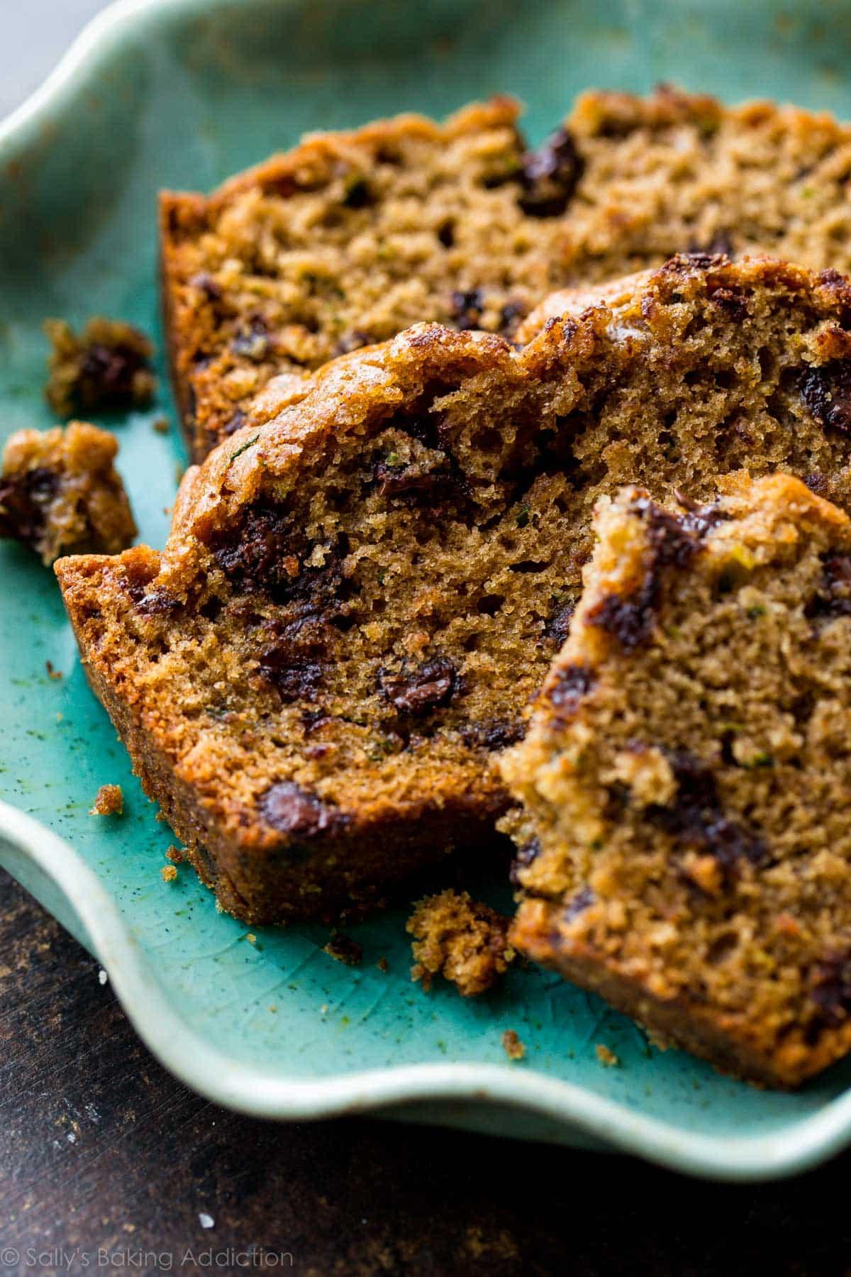 Here's an award winning recipe for zucchini bread + zucchini bread muffins! With brown sugar, vanilla, and cinnamon, you can't taste the zucchini! Recipe on sallysbakingaddiction.com