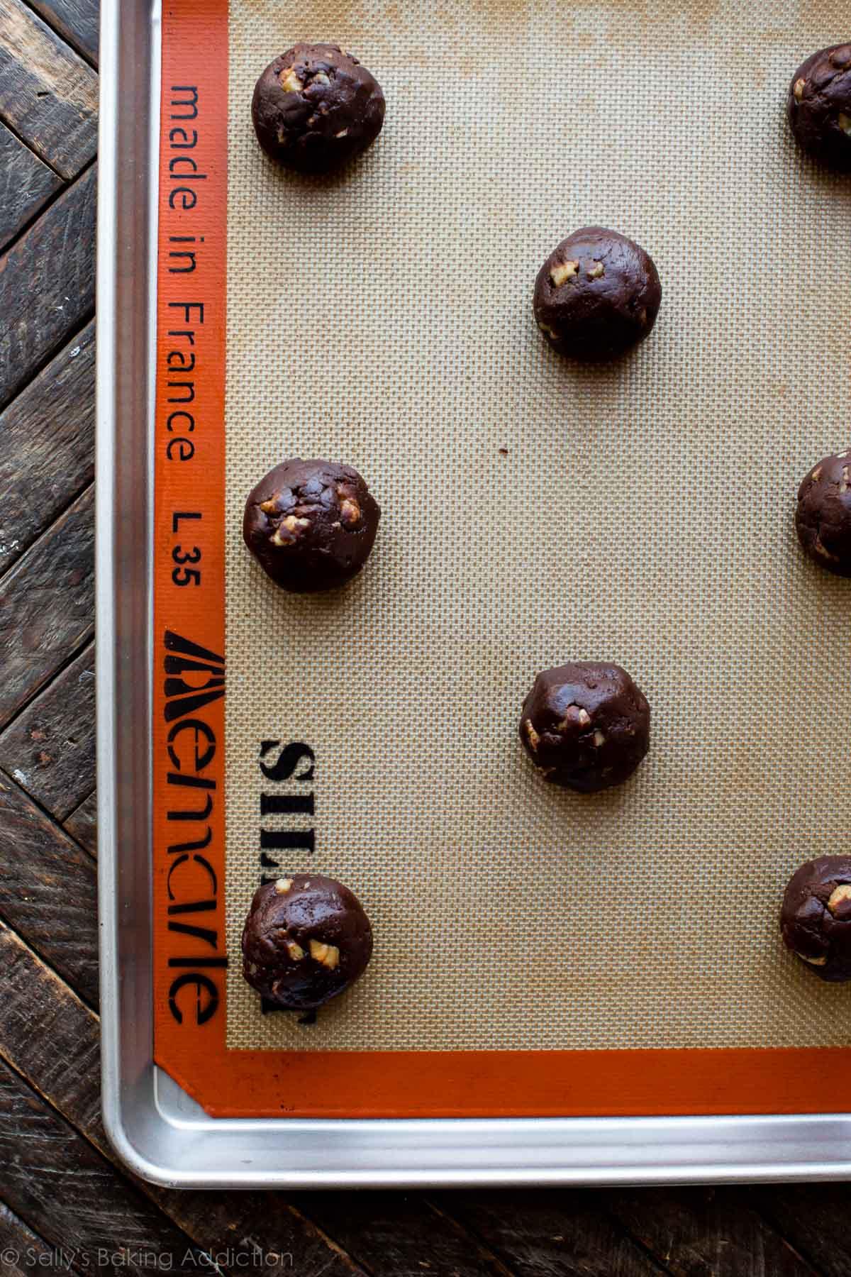 How to make super fudge walnut chunk brownie cookies on sallysbakingaddiction.com
