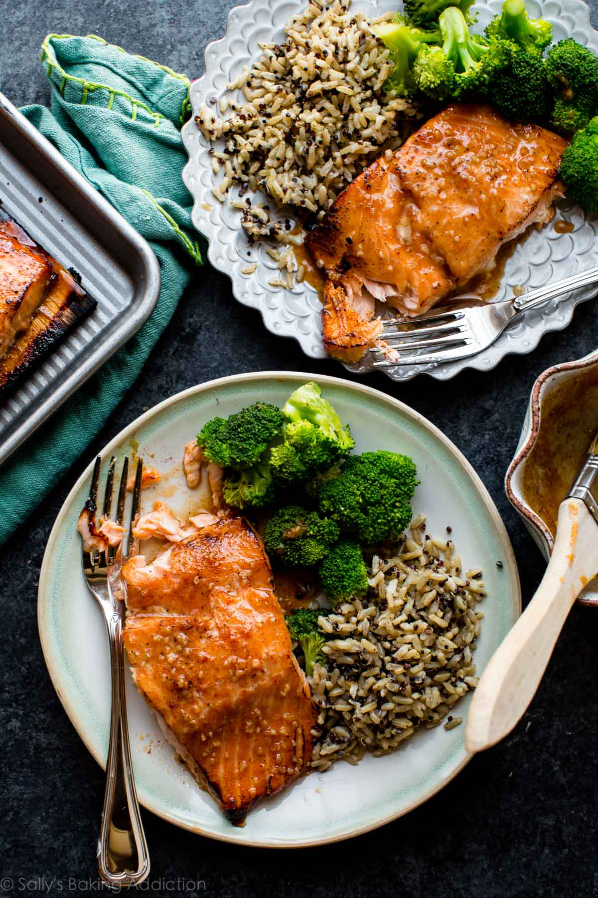5 ingredient honey chipotle salmon with delicious garlic honey butter on top! Moist and tender with crispy edges. Grilled or baked salmon! Recipe on sallysbakingaddiction.com