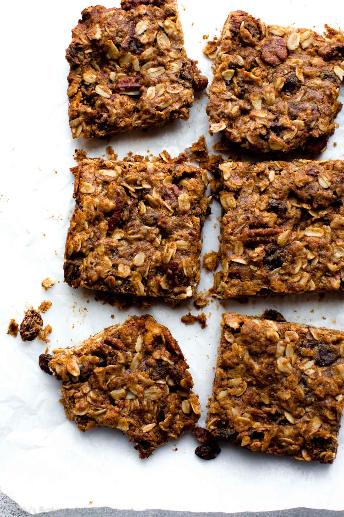 Super soft oatmeal granola bars that taste like oatmeal raisin cookies! Recipe on sallysbakingaddiction.com