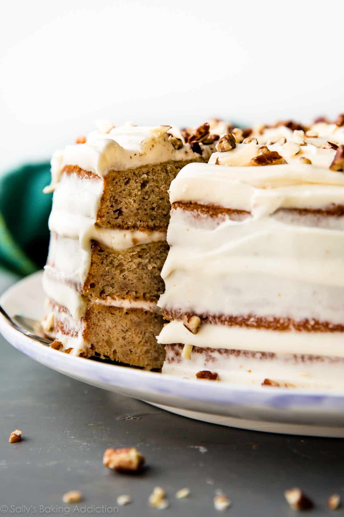 Best banana layer cake recipe with brown butter cream cheese frosting!! So easy to make. Moist, delicious, simple homemade cake! Recipe on sallysbakingaddiction.com