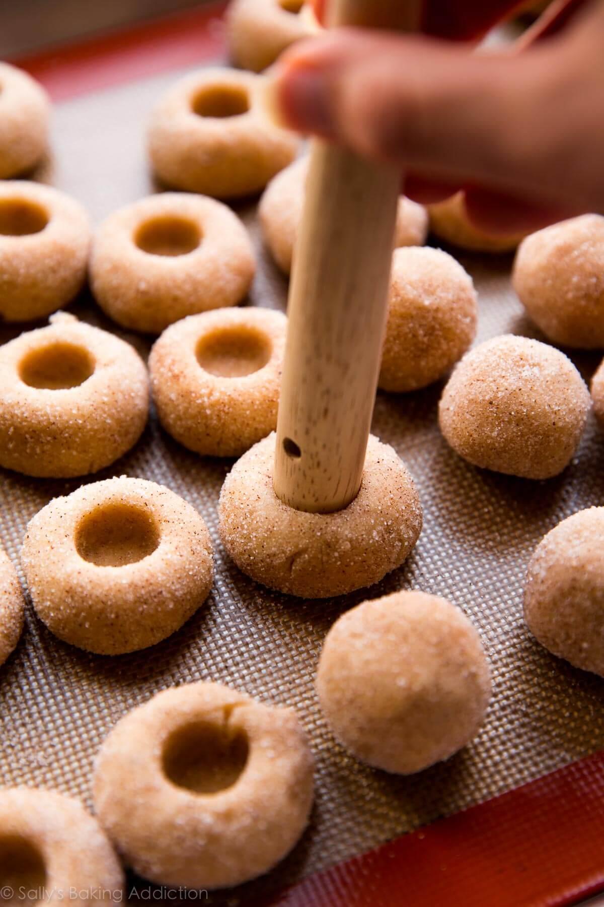 How to make thumbprint cookies! Recipe on sallysbakingaddiction.com