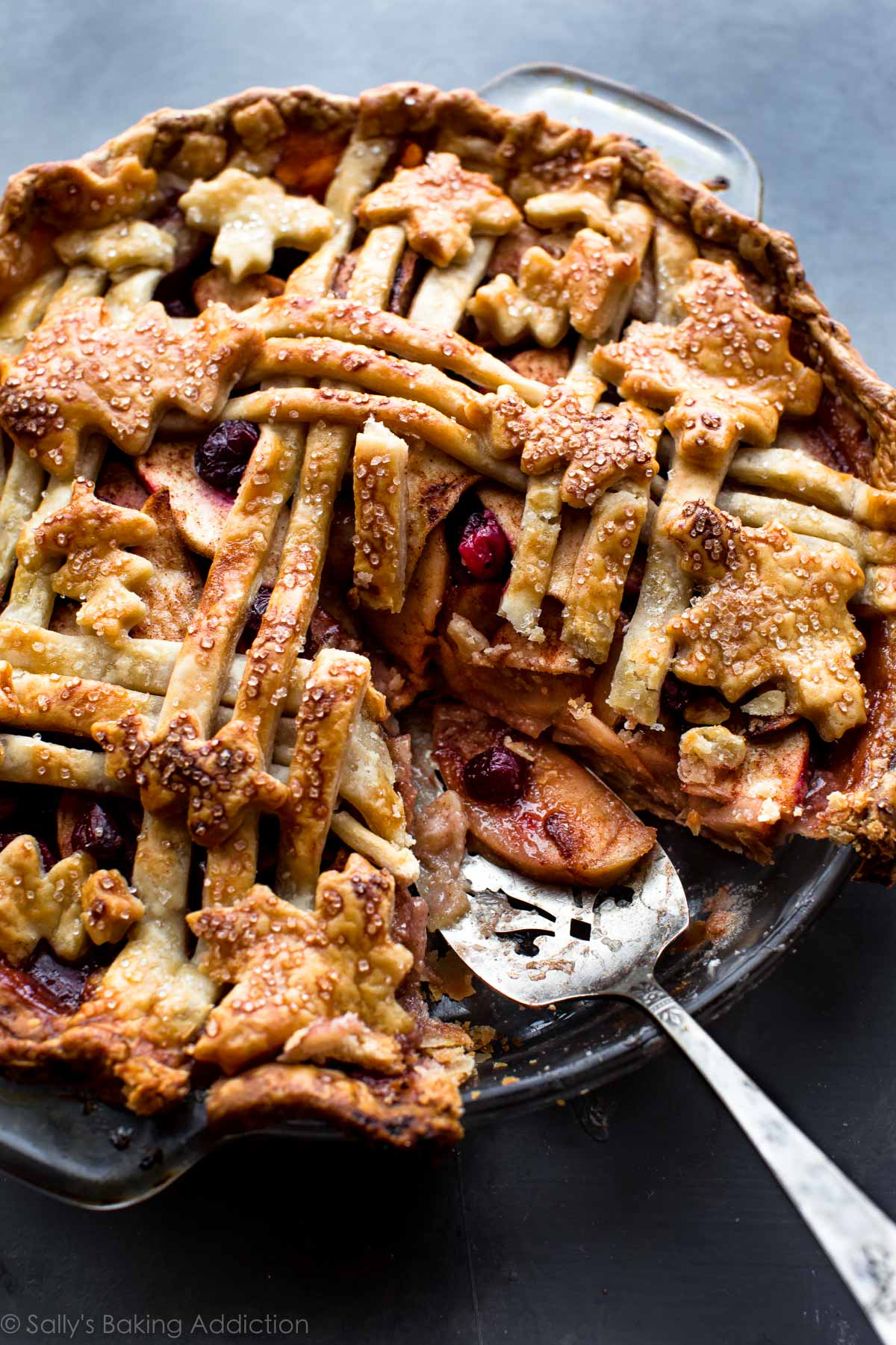 This cranberry almond apple pie is the Thanksgiving dessert that everyone will be talking about! The flavor is divine and it couldn't be easier to make. Recipe on sallysbakingaddiction.com