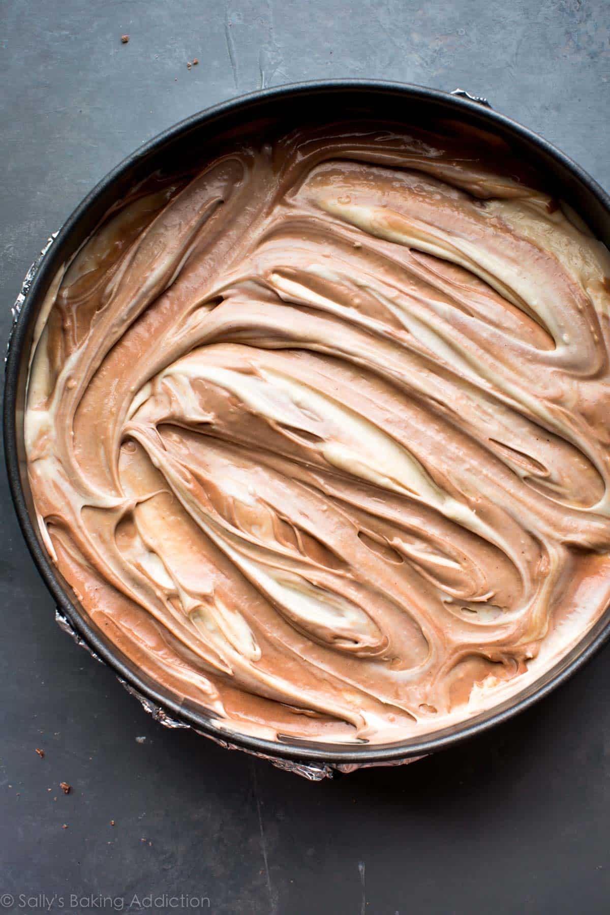 Snickers cheesecake batter on sallysbakingaddiction.com