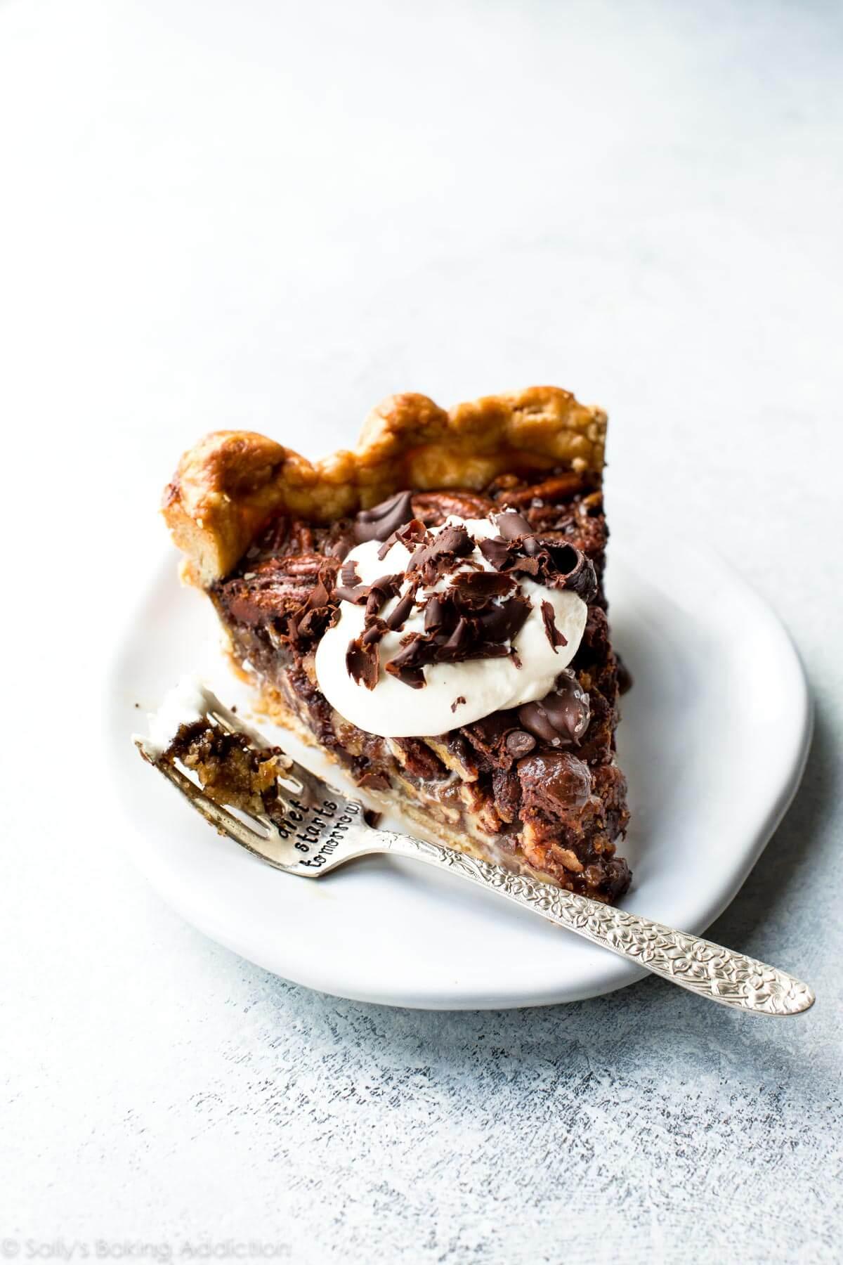 Deep decadent and delicious dark chocolate pecan pie with sea salt! Recipe on sallysbakingaddiction.com