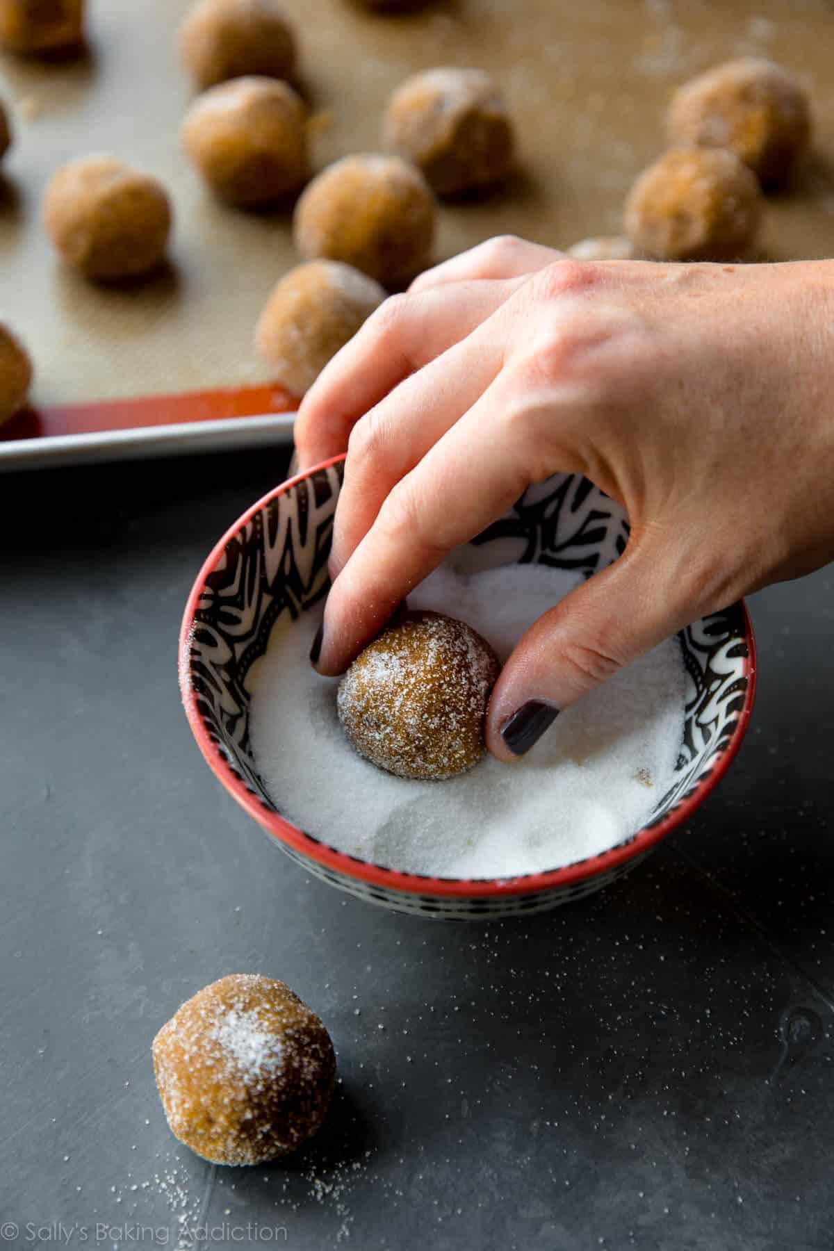 Rolling molasses cookie dough into balls on sallysbakingaddiction.com