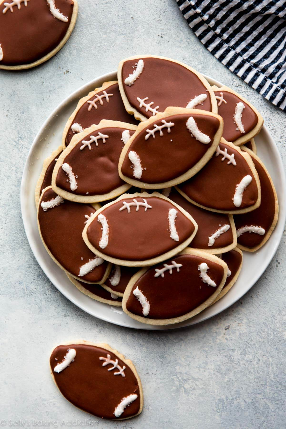 How to make adorably decorated football cookies! Recipe on sallysbakingaddiction.com