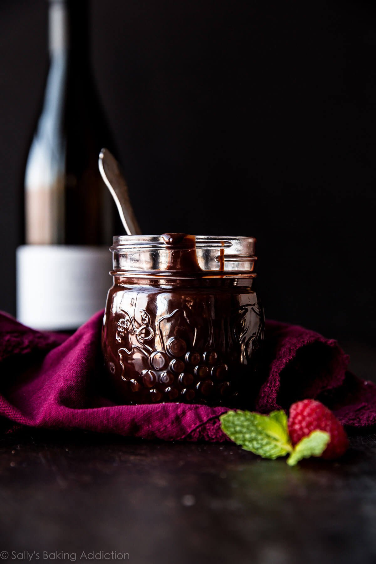 Silky, thick, rich, and smooth chocolate sauce made with red wine! This chocolate ganache is delicious on ice cream, cakes, cupcakes, pound cakes, and more! Recipe on sallysbakingaddiction.com