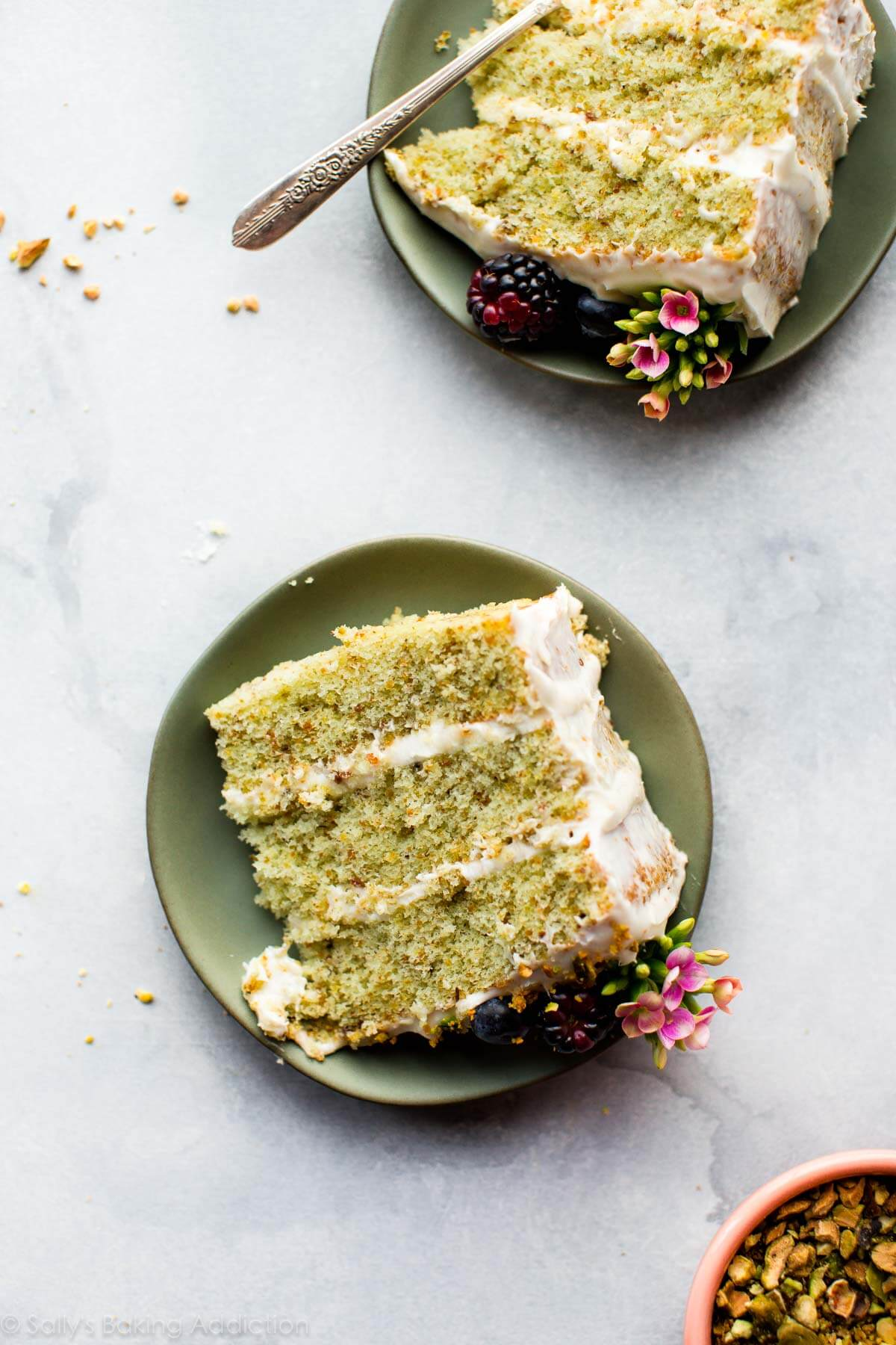Pistachio cake from scratch with real pistachio and almond extract flavors! Nothing fake or artificial in this beautiful 3 layer pistachio cake. This rustic chic naked cake is adorned with silky cream cheese frosting! Recipe on sallysbakingaddiction.com