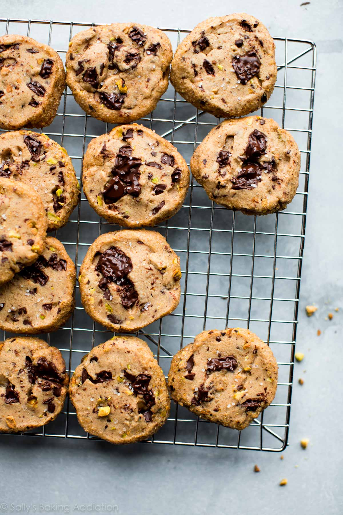 Salted pistachio chocolate chunk cookies have pistachio chunks, dark chocolate, brown sugar, sea salt, and a crunchy sugar edge! Recipe on sallysbakingaddiction.com