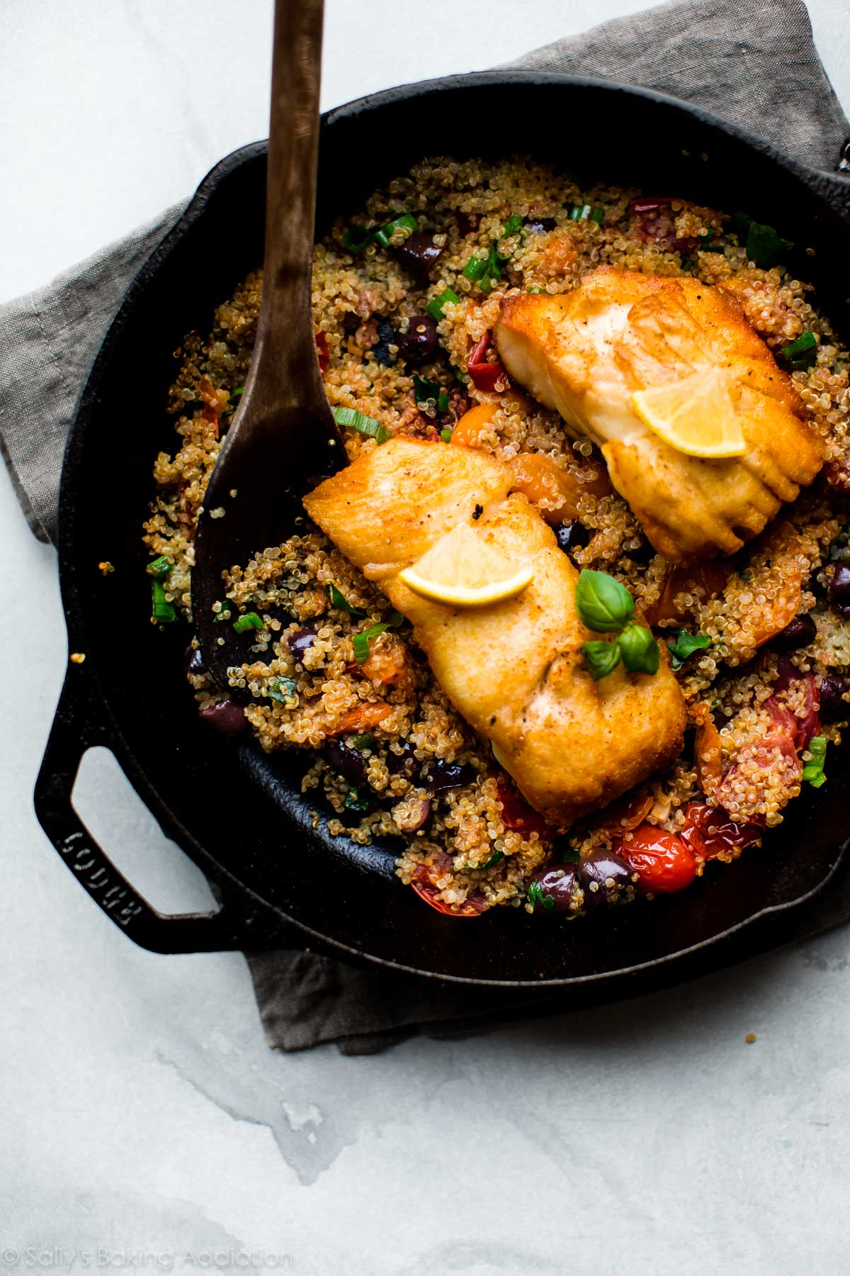 Full of fresh and seasonal flavors, this crispy pan-seared halibut with tomato basil quinoa is a healthy and naturally gluten free meal that's easy, quick, and satisfies! Recipe on sallysbakingaddiction.com