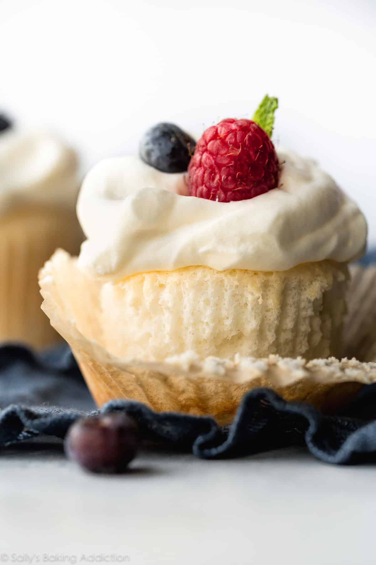 This easy recipe for angel food cupcakes is the perfect light dessert! Made from just a few ingredients, this angel food cake is light as air and topped with fluffy whipped cream. Recipe on sallysbakingaddiction.com
