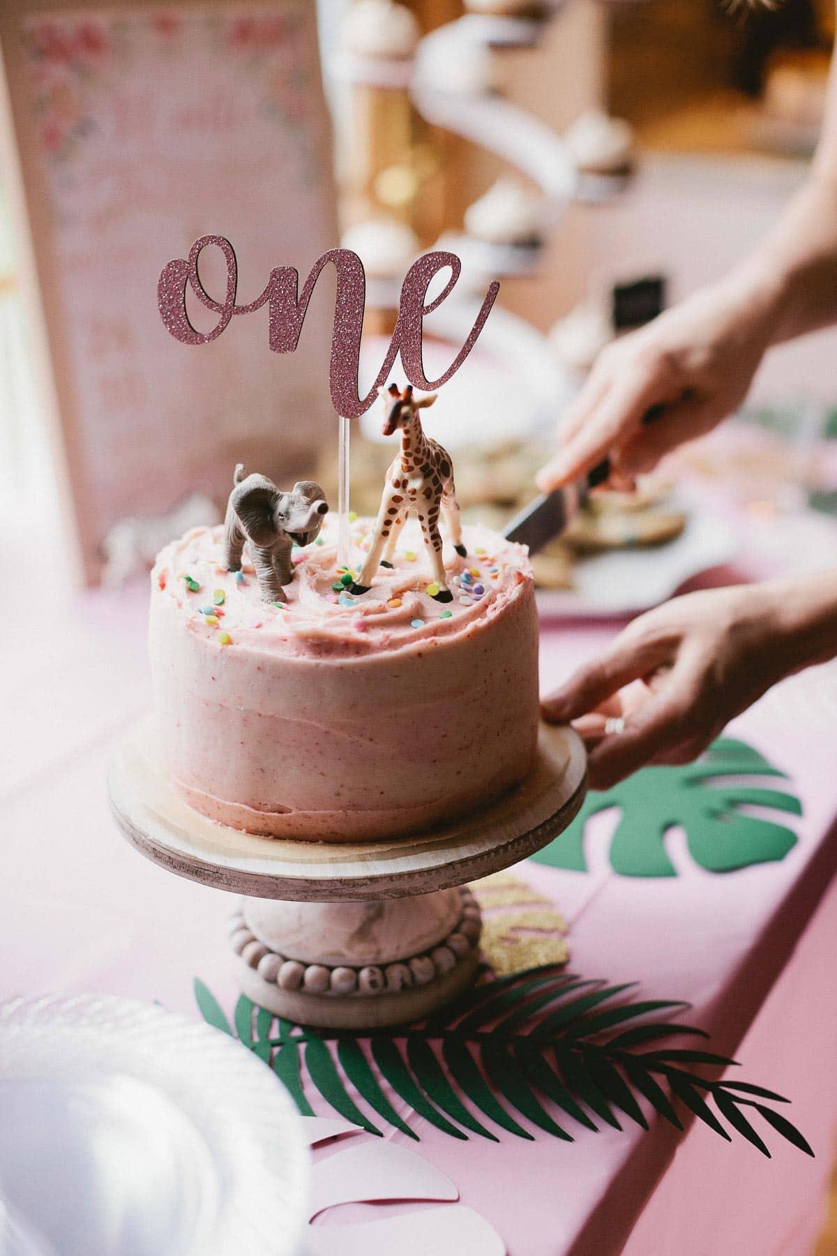 Pink safari 6-inch 3 layer 1st birthday cake with marble cake and strawberry frosting. Recipe on sallysbakingaddiction.com